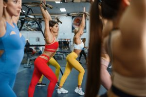 Women with slim body doing exercise in gym